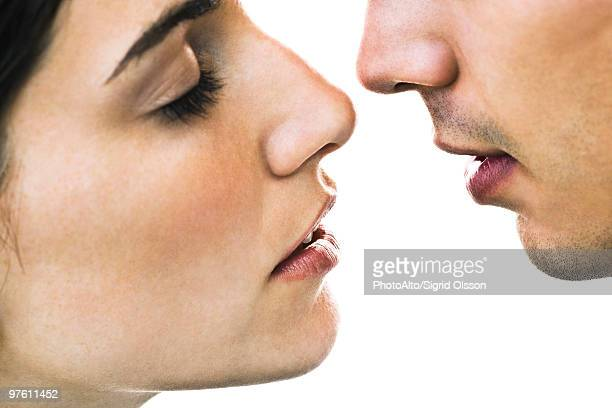 Couple about to kiss, close-up