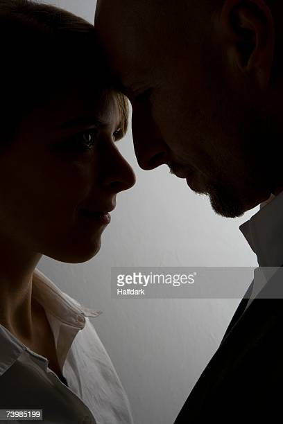 couple about to kiss - forehead stock pictures, royalty-free photos & images