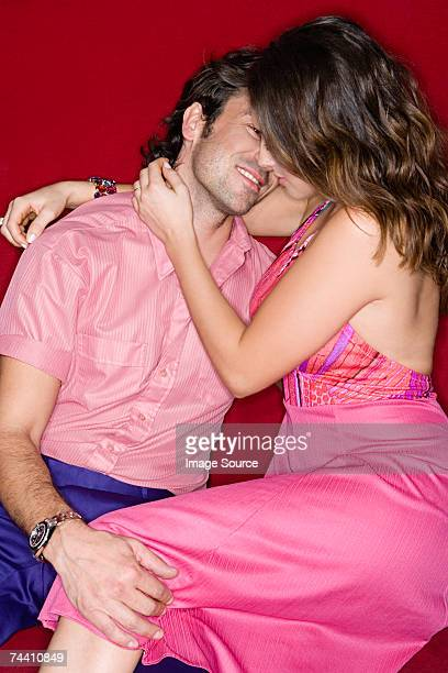 couple about to kiss - leg kissing stock photos and pictures