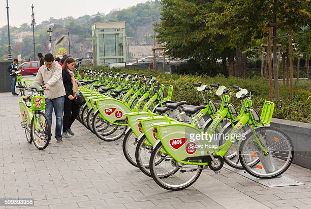 Couple about to rent one of the rental bikes or bicycles called MOL Bubi or NextBike on streets of Budapest, Hungary