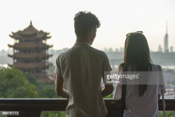 A couple admire a general view of Wuhan and Yellow Crane Tower situated on Sheshan On Monday September 14 2016 in Wuhan China