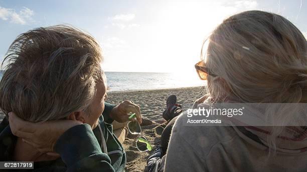 Couple admire the seashore in the evening sunlight