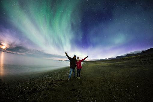 Couple admiring Aurora Borealis in Iceland - gettyimageskorea