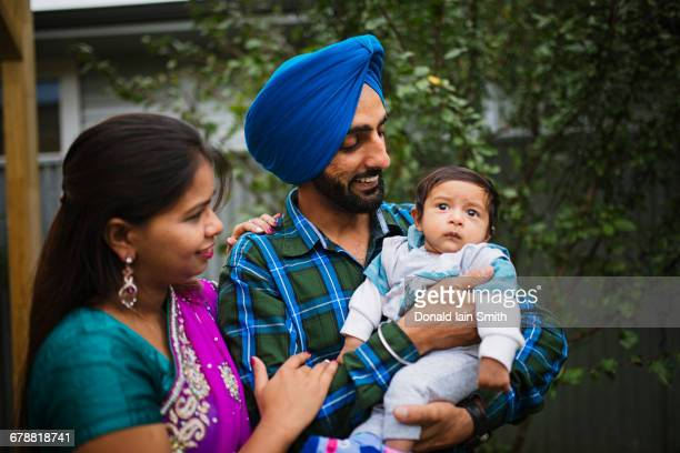 couple admiring baby son - sikh stock pictures, royalty-free photos & images