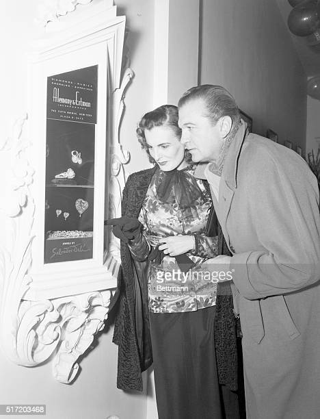 Couple admiring jewelry designed by artist Salvador Dali showcased in the lobby of the El Morocco Nightclub 154 East 54th Street New York City