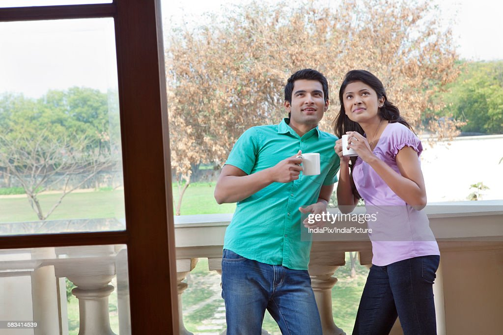 Couple admiring new house : Stock Photo