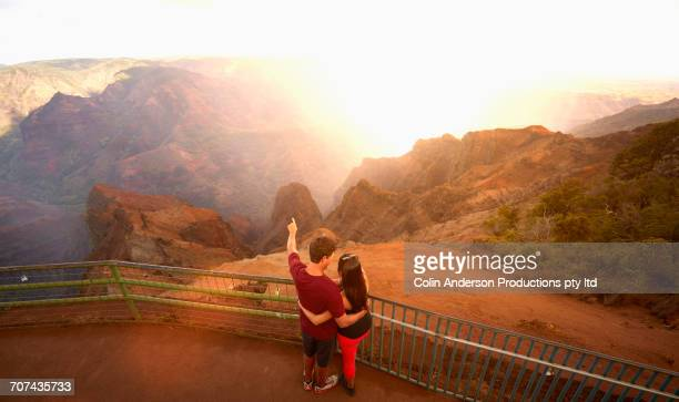 Couple admiring scenic view of rocky landscape