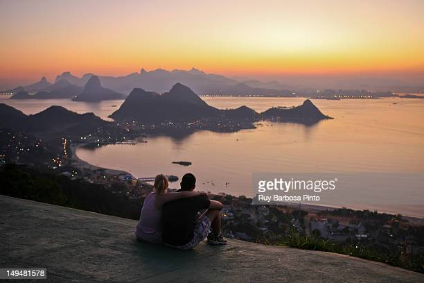 Couple admiring sunset