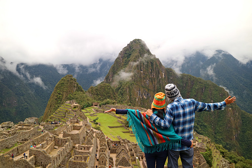 Couple admiring the spectacular view of Machu Picchu, Cusco Region, Urubamba Province, Peru, Archaeological site, UNESCO World Heritage 984199180