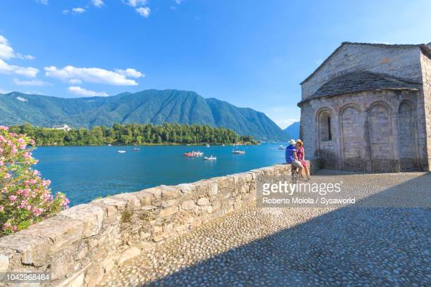 couple admiring the view, ossuccio - como italy stock pictures, royalty-free photos & images