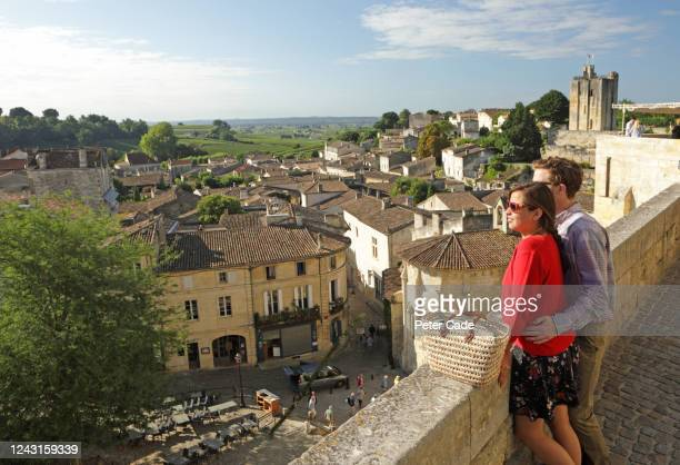 couple admiring view of historic town - gironde stock pictures, royalty-free photos & images