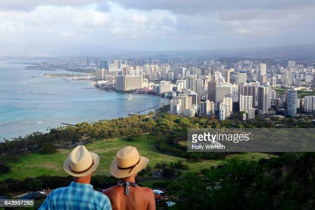 Couple admiring Waikiki cityscape, Hawaii, United States
