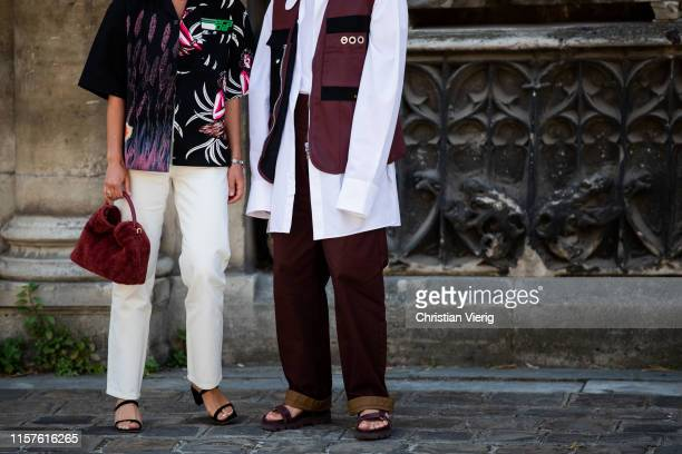 Couple Alice Barbier wearing Prada shirt white pants and JeanSebastien Roques seen wearing vest bordeaux pants white button shirt outside Thom Browne...