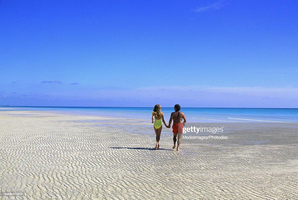 Couple alone on beach at Lucayan National Park, Grand Bahama Island, Bahamas : Stock Photo