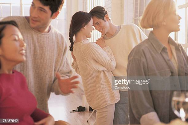 couple among others at party - category:cs1_maint:_others stock pictures, royalty-free photos & images