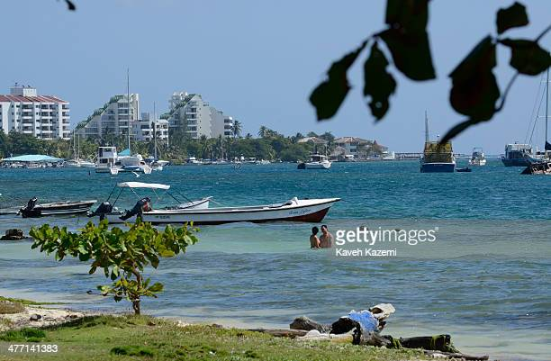 A couple amuse themselves on the seafront with ancored boats in the background on January 24 2014 in San Andres Colombia Colombia has a territorial...