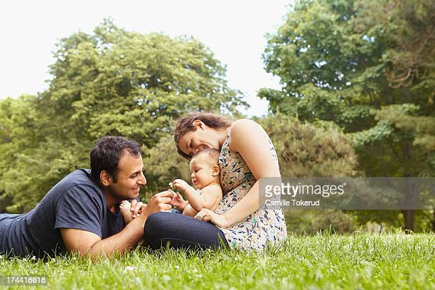 Couple and baby son sharing time in park