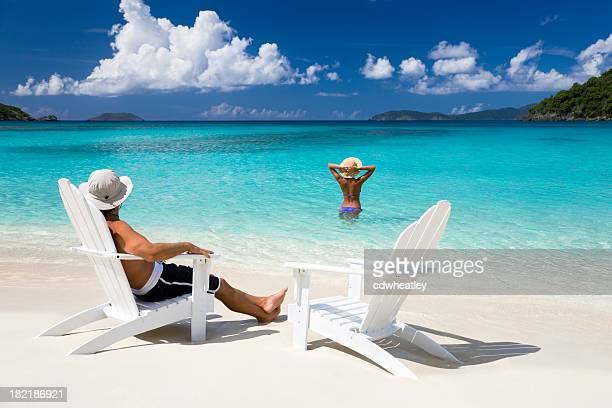 couple and chairs at a beach