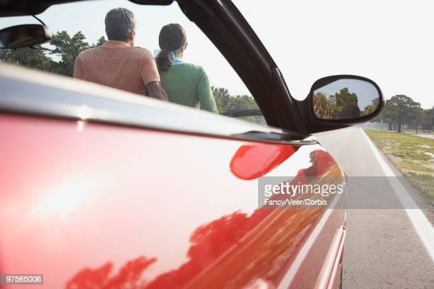 couple and convertible - next to stock pictures, royalty-free photos & images