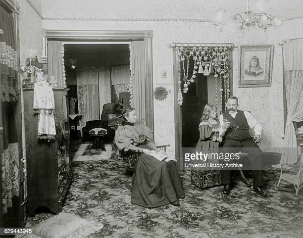 Couple and Daughter in Victorian Parlor USA circa 1890