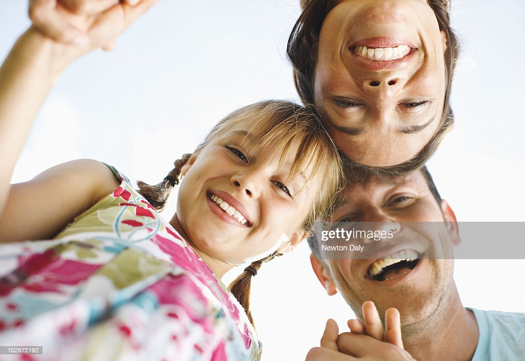 Couple and daughter (8-9) smiling : Stock Photo