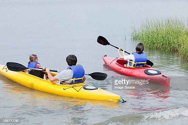 couple and daughters kayaking - hilton head stock pictures, royalty-free photos & images