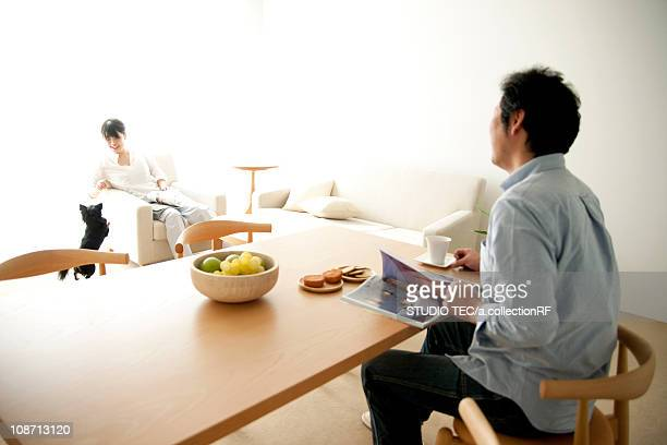 Couple and dog at dining/living room