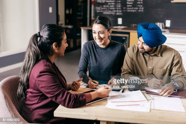 couple and financial advisor - indian stock pictures, royalty-free photos & images