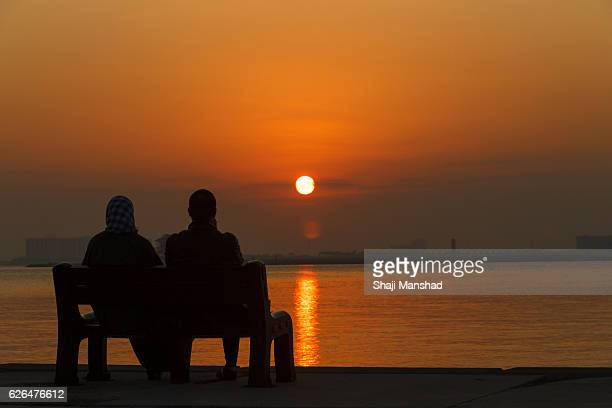 Couple and lady watching sunrise
