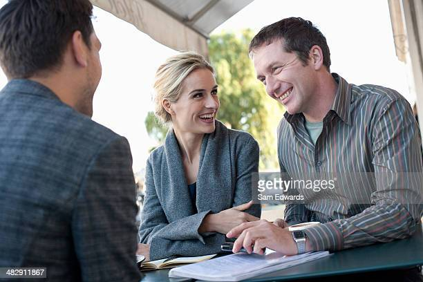 Couple and man on outdoor patio