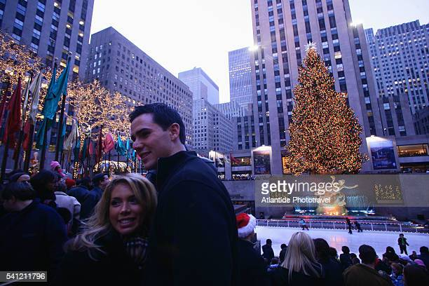 Couple and Rockfeller Plaza at Christmas