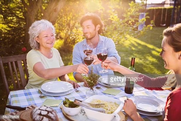couple and senior woman having dinner in garden - in law relations stock pictures, royalty-free photos & images