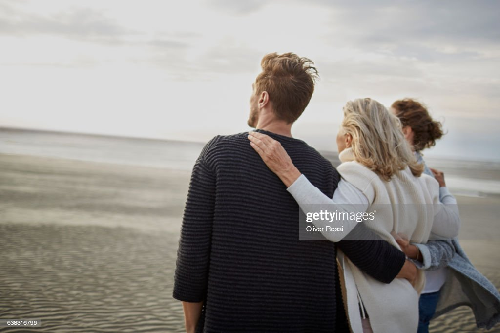 Couple and senior woman on the beach : Stock Photo