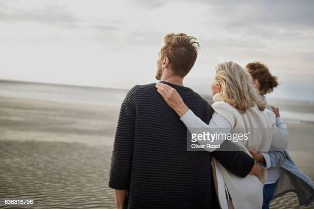 Couple and senior woman on the beach