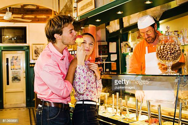 Couple and shopkeeper in gelateria, Florence, Italy