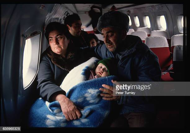 A couple and their baby daughter who survived the devastating earthquake in Armenia are evacuated by plane from Leninakan to Yerevan