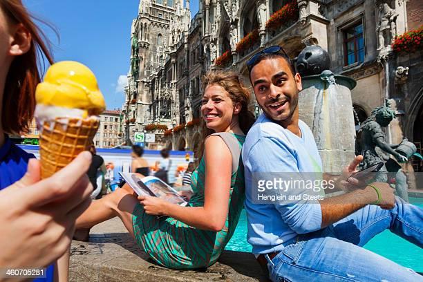 Couple and woman with ice cream, Munich Marienplatz, Munich, Germany
