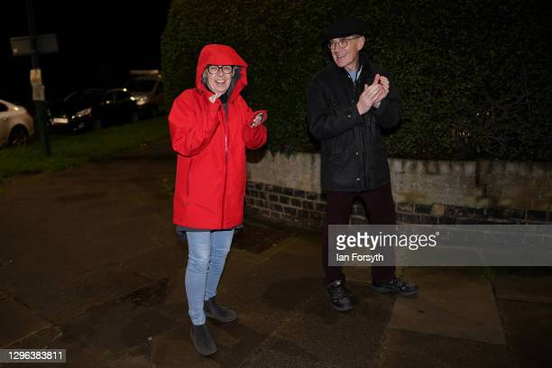 Couple applaud as they take part in the Clap for Heroes event on January 14, 2021 in Saltburn-by-the-Sea, England. During the first Coronavirus...