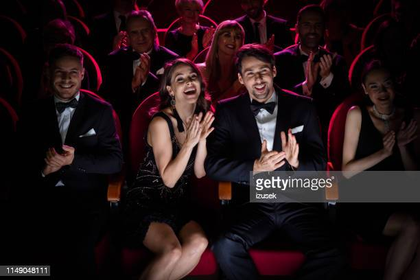couple applauding while watching opera - applauding stock pictures, royalty-free photos & images