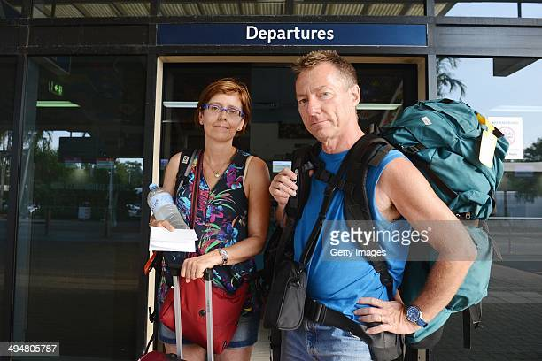 A couple are pictured outside of Darwin airport on May 31 2014 in Darwin Australia Flights in and out of Darwin have been suspended as volcanic ash...