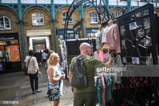 Couple are seen browsing stalls in Covent Garden on September 8, 2021 in London, England. The UK retail sector has suffered during the periods of...