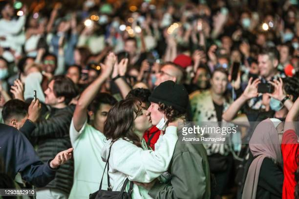 Couple are seen kissing as they bring in the New Year at Federation Square during New Year's Eve celebrations on January 1, 2021 in Melbourne,...