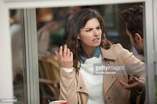 couple arguing in a cafe - displeased stock pictures, royalty-free photos & images