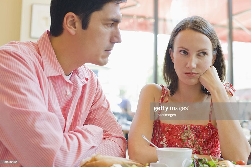 Couple arguing in cafe : Stock Photo