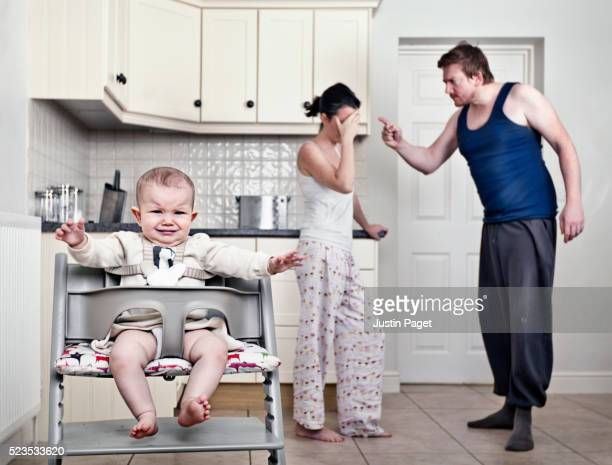 Couple Arguing in front of Infant