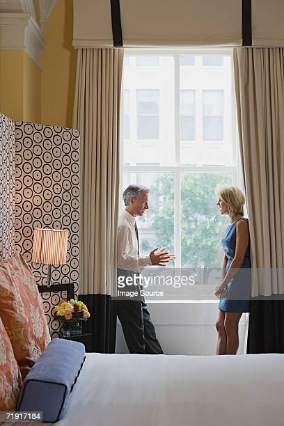 Couple arguing in hotel room