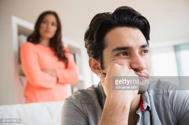 Couple arguing in living room