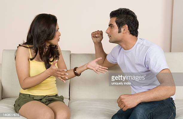 Couple arguing on a couch