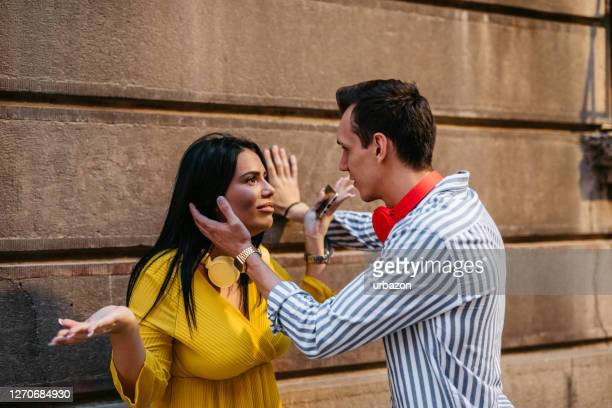 couple arguing outdoors - fiancé stock pictures, royalty-free photos & images