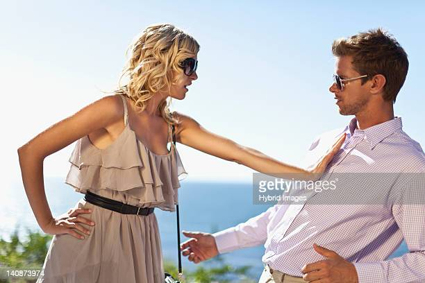 couple arguing outdoors - dismissal stock photos and pictures